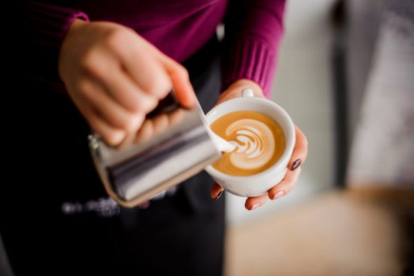 barista-making-coffee-latte-art-coffee-shop_130488-996